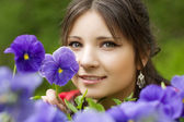 Girl with spring flowers — Stock Photo