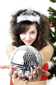 Santa girl disco ball in the hands — Stock Photo