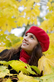 Woman in red in autumn park — Stock Photo