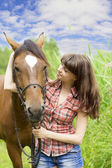 Brunette girl with horse — Stok fotoğraf