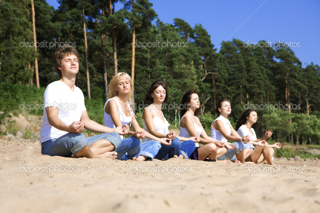Image of a group of sitting on the beach  Stock Photo #7489202