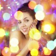 Beautiful girl in the bright night lights — Stock Photo