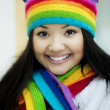 Girl in a scarf and hat of rainbow colors — Stock Photo #7532515
