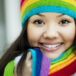 Girl in a scarf and hat of rainbow colors — Stock Photo #7532521
