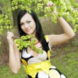 Girl and blossoming spring plants — Stock Photo