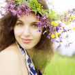 Stock Photo: Girl wearing wreath of wild flowers in field