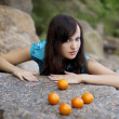 Beautiful young girl with the mandarins in nature — Stock Photo #7533207
