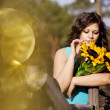 Girl in the countryside with sunflowers — Stock Photo