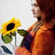 Pretty girl walking with a sunflower city — Stock Photo