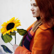 Pretty girl walking with a sunflower city — Stock Photo #7538772