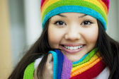 Girl in a scarf and hat of rainbow colors — Stock Photo