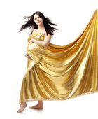 Beautiful cute pregnant girl in gold — Stock Photo
