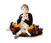 Little girl with a cat on a white background — Stock Photo