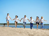 Group of relaxing on the beach — Stock Photo