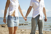 Beautiful in love on the beach — Stock Photo