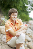 Portrait of a cute guy on the nature — Stock Photo