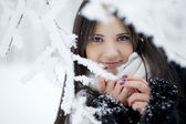 Beautiful girl in winter forest — Stock Photo