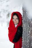 Beautiful girl in winter forest in red — Stock Photo