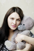 Pregnant woman with bear — Stock Photo