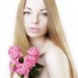Beautiful girl on a white background with roses — Stock Photo
