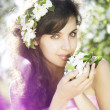 Beautiful girl was blossoming garden — Stock Photo
