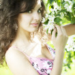 Beautiful girl was blossoming garden - Stock Photo