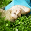 Beautiful girl lying on the grass — Stock Photo #7615713