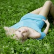 Stock Photo: Beautiful girl lying on the grass