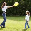 Stock Photo: Mother playing with her daughter in the park