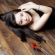 Beautiful asian girl with a violin — Stock Photo