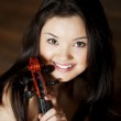 Beautiful asian girl with a violin — Stock Photo #7616017