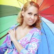 Stock Photo: Beautiful pregnant girl with a rainbow umbrella