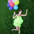 Stock Photo: Woman holding bunch of colorful air balloons