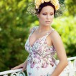 Beautiful pregnant girl with a wreath of flowers — Stock Photo #7616325