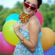 Bright woman in sunglasses - Stock Photo
