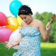 Pregnant girl surprised - Stock Photo