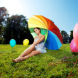 Pregnant woman rainbow umbrella — Stock fotografie