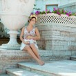 Beautiful pregnant woman near the palace — Stock Photo #7616482