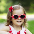 Foto de Stock  : Little girl in fashionable sunglasses