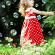 Cute little girl with bubbles — Stock Photo #7616856