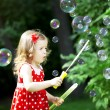 Cute little girl with bubbles — Stock Photo #7616862