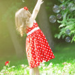 Cute little girl with bubbles — Stock Photo