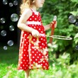 Stock Photo: Cute little girl with bubbles