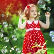 Cute little girl with bubbles — Stok fotoğraf