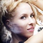 Beautiful girl on a dark background — Stock Photo