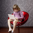 Girl sitting in a chair with a laptop — Stock Photo #7617266