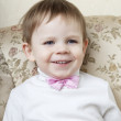 Cute little boy on a background of vintage sofa — Stock Photo
