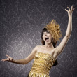 Pretty girl singing in the glamorous background — Stock Photo