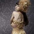 Luxurious glamorous models in gold — Stock Photo
