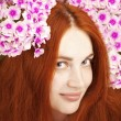 Beautiful girl with flowers in her hair — Stock Photo #7617535